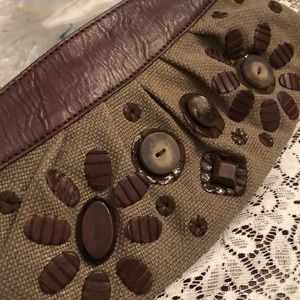 Fossil clutch with button and bead detail